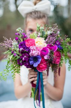 Bright orchid and deep purple bouquet. #bouquet #radiantorchid #weddingchicks Floral Design: Swoon Floral Design ---> http://www.weddingchicks.com/2014/05/01/alice-in-wonderland-wedding-ideas/