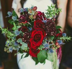 Sophisticated Bridal Bouquet Showcasing: Blue Eryngium Thistle, Scarlet Roses, Deep Red Striated Hocus Pocus Roses, Red Amaranthus, Green Amaranthus,  Wild Raspberries, & Several Varieties Of Greenery/Foliage