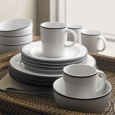 Same as all-white version, but with blue band.  Roulette Blue Band 20-Piece Dinnerware Set | Crate and Barrel