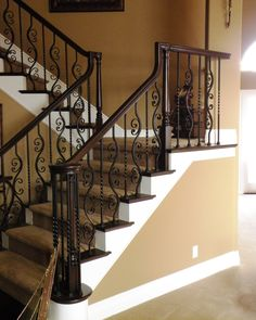 VERY similar stairwell look if we changed the wrought iron banisters to black.