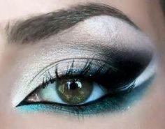 White + Black Eyeshdow with Black + Teal Eyeliner.
