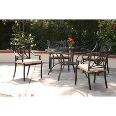 Star 5 Piece Dining Set Fabric: Beige by AIC Garden & Casual. $747.00. I202-65S-06-A502-C Fabric: Beige Features: -Material: Cast and extruded aluminum, tempered glass, polyester fiber.-Contoured backrest and padded seat cushion warrant comfort.-Non-toxic long lasting powder coat.-Stackable arm chairs for storage convenience.-Tempered glass top with 2'' umbrella hole.-Adjustable nylon glides on chair legs. Options: -Available in Beige and Striped cushions fabrics. Co...