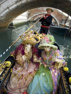 Couple at the Annual Carnival Festival Enjoy Gondola Ride, Venice, Italy