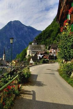 Beautiful Hallstatt, Austria. The village Hallstatt is an unbelievably spectacular place. Look at those window boxes up high.