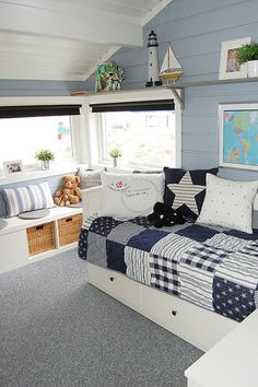 Navy and white quilt. Big patchwork. Maybe for downstairs guest bedroom.