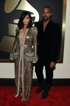 Kim Kardashian and Kanye West walk the red carpet at the 57th Annual Grammy Awards.