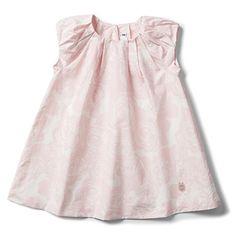 Her first designer Baby Dior dress