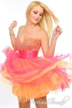 Precious Formals Style P20973 Layers of colorful net and a glittering bodice amp up the volume and style of this sweetheart-neck Fit & Flare short frock.