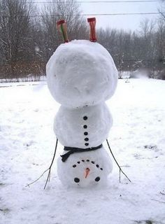 Handstand   Community Post: 40 Creative Snowmen and Other Snow Sculptures