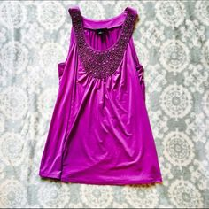 Sleeveless Dress Top Beautiful, barely worn sequined top! Super cute and flattering as it has a loose fit. I normally wear a Medium but this fits me great! Looks great with dress pants, but can also dress up a pair of jeans! Make me an offer! Iz Byer Tops