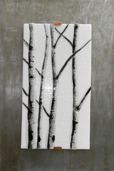 Fused glass is handcrafted to create mountable wall art.  Love the simplicity of this birch tree design on a white snowy background.