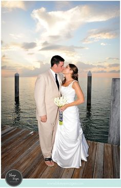 """Beautiful beach wedding! We especially love the sign - """"No need to pick a side, simply pick a seat. Today, two families become one."""" That has One Human Family (Key West's official motto) literally written all over it! Congrats Amberlee & Patrick! To have your wedding with us, call 305.292.4366. Thanks to Studio Marie-Pierre Key West Hair & Makeup for the blog and Blueye Images for the photos!"""