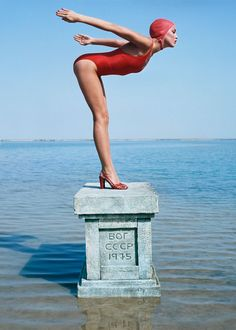 """American model Jerry Hall wearing a swimsuit by Martil and lipstick red sandals by Manolo Blahnik. The plinth she is standing on was commissioned especially for the shoot and was inscribed """"Jerry Hall, Vogue Magazine in the USSR, British Vogue, January Jerry Hall, Norman, Fashion Shoot, Editorial Fashion, Women's Fashion, Fashion Trends, Martin Munkacsi, Vogue Photographers, Fashion Fotografie"""