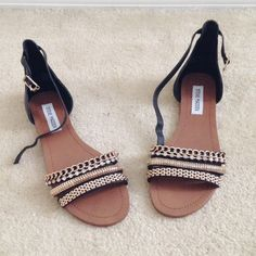 Steve Madden Bidazz Flat Sandals Two-piece leather upper ankle strap with adjustable buckles. metal chain details and rhinestone embellishments. Size 7M Steve Madden Shoes Sandals