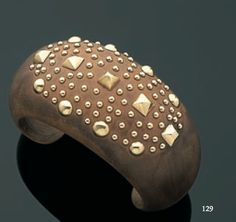 Sandalwood cuff, set with 18ct gold, designed by Suzanne Belperron for René Boivin, circa 1933.