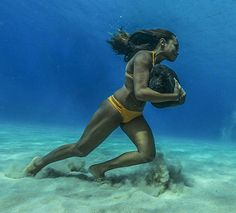 Hawaiian Surfer Trains Across The Ocean Floor With A 50 Pound Rock Photography By: Paul Nicklen