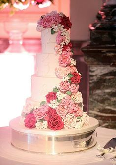 """Beautiful Four Tier Wedding Cake With Scrolling Design & """"Cascading"""" Sugar Flowers in Lovely Color Combination of Blush, Pink, Hot Pink, White, & Pretty Green Leaves On The Flowers...Extremely Intricate & Well Done, Gorgeous Cake!"""