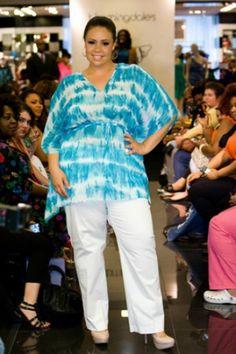 Models walk the runway during Full Figured Fashion WeekRichard Lew[content:shareblock]