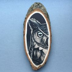 Wood slice with an original drawing of a horned owl, wall decoration