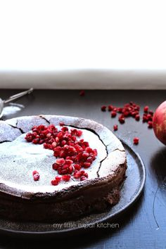 My Little Expat Kitchen: Flourless dark chocolate and demerara sugar cake with pomegranate seeds (GF)