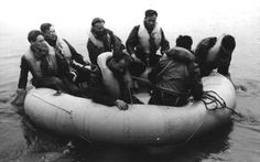 Dingy afloat containing seven aircrew, RAF Waterbeach, 1944-1945