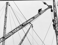 """reinopin: Lewis Hine, """"Placing the Derrick High Up on Empire State Building"""", 1931. Lewis Hine, published by D.A.P."""