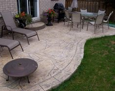 Love the flagstone pattern with the rectangle border, all stamped concrete