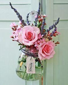 hanging mason jar full of beautiful flowers