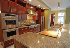 We love New Venetian Gold granite countertops due to the versatility of color and style. This granite simply adds a touch of warm elegance to any kitchen. Cherry Wood Kitchen Cabinets, Cherry Wood Kitchens, Hickory Kitchen Cabinets, Cherry Kitchen, Cream Tile Floor, New Venetian Gold Granite, Cost Of Granite Countertops, Warm Color Schemes, Granite Colors