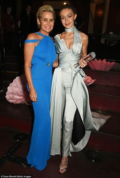 Like mother, like daughter! Gigi was also getting some support from her mother Yolanda as they posed up a storm at the Royal Albert Hall in London on Monday night