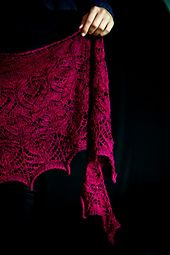Mad Blood is a dramatic crescent shaped shawl positively dripping with lace, cables, beads and nupps. This shawl is inspired by the gorgeous ruby red colour of a beautiful yarn - a rich blue based red with just a hint of pink. Knitsch Sock: The Mad Blood Stirreth.