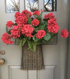 Beautiful and large Red Geranium Door Basket to use through spring and summer. Lush geraniums mix with ferns creating a spectacular door piece. Potted Geraniums, Red Geraniums, Potted Plants, Fall Containers, Succulents In Containers, Container Flowers, Container Plants, Fake Flowers, Silk Flowers