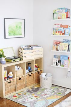 Great toy storage in a nursery - we love that this corner creates a designated area for play!