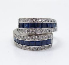 The ring is superbly crafted in 18k white gold with sleek contemporary lines evocative of the bold simplicity of the Art Deco movement. The ring features 18 square cut sapphires, each in a vivid shade of rich deep blue, surrounded by 58 round brilliant cut diamonds of GH/SI-I quality. | eBay!