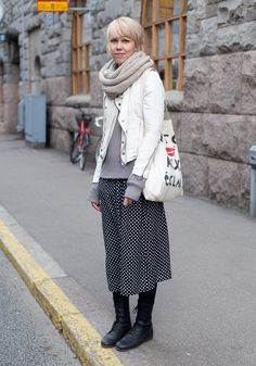"""Jutta, 27  """"I'm wearing a second hand jacket, a dress from Kuala Lumpur, Diesel shoes and a Maison Scotch bag.    I like pastel colours and ankle-length skirts. I often shop at Zara and COS.""""  4 May 2012, Uudenmaankatu"""