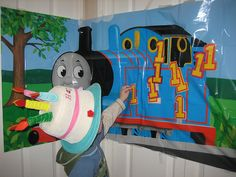 Pin the #1 on Thomas the Tank Engine we played at my son's birthday party.  Other party activities include playing with Thomas Trains.