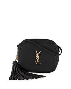 "Saint Laurent calfskin leather crossbody bag. Golden hardware. Adjustable crossbody/shoulder strap; 23.5"" drop. Zip-top closure. Hanging tassel detail on side. YSL logo plate on body. Interior pockets"
