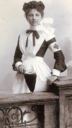 A young nurse. Unknown date, but the Red Cross on her sleeve would make it after 1880 when Amer. Red Cross came into existence.