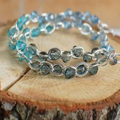 Learn how to make a unique wrap bracelet with beads and chain.