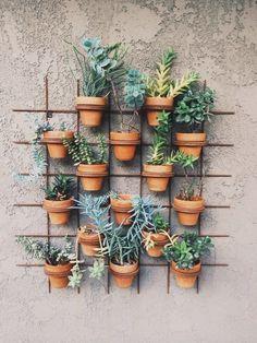 Living Garden Wall of Terra Cotta Pots | Happy Mundane Photography | See More! http://heyweddinglady.com/natural-earthy-wedding-inspiration-in-terra-cotta-gold-green/