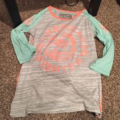 Women's American fighter shirt 3 quarter sleeved. Worn only for a few hours. Good condition. Buckle Tops
