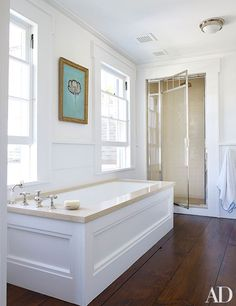 The master bath is equipped with Lefroy Brooks glass shelves and sink fittings.