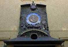 Clock with people drinking at a bar while a cemetery is embedded below, in Žatec, Czech Republic (photograph by SchiDD/Wikimedia) British Library, Czech Republic, Cemetery, Alarm Clock, Drinking, Photograph, London, Display, Bar