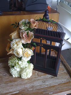 cage wedding floral arrangements   ... wedding. They can also be used to collect cards from your guests. Here