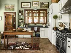 Christopher Vazquez and Rick DAvis of Amaryllis Floral and Event Design in Maryland decorated a saltbox home in Maryland with rustic farmhouse style. This Old House, Brick Flooring, Kitchen Flooring, Kitchen Countertops, Floors, White Kitchen Cabinets, Painting Kitchen Cabinets, Brick Style Tiles, Sage Green Walls