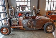 Go Away Garage. This is the old 32 Roadster body that Mike found on American Pickers and had built in to a Traditional Rod... NO, its not a Rat Rod!