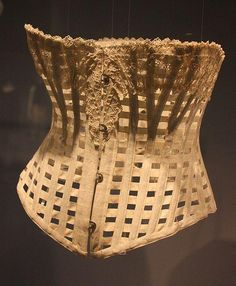 Foundations Revealed  English corset of 1890-1900, made from whalebone and cotton, with steel busk and back supports. This 'ventilated' design was a reaction against the scare stories of the late C19th about the dangers of wearing corsets. It was considered suitable for sports and hot summer days as it allowed perspiration to evaporate! (Public doman image - commons.wikimedia.org)