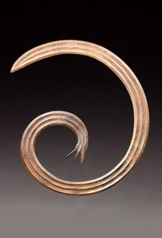 Indonesia - Central Sulawesi | Spiral head ornament; brass with aged patina. 19 x 22,5 cm | 850€ ~ sold (Mar '15)