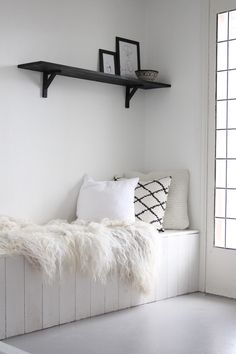 love the mix of textures and the pop of black in the shelf and pillow.
