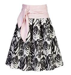 Midi εμπριμέ ψηλόμεση φούστα με μπάσκα και σχέδιο με πιέτες. Σχεδιασμένη σε Α γραμμή.